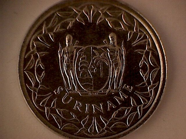 1 Cent Coin From Suriname Shows The Coat Of Arms Featuring A Slave