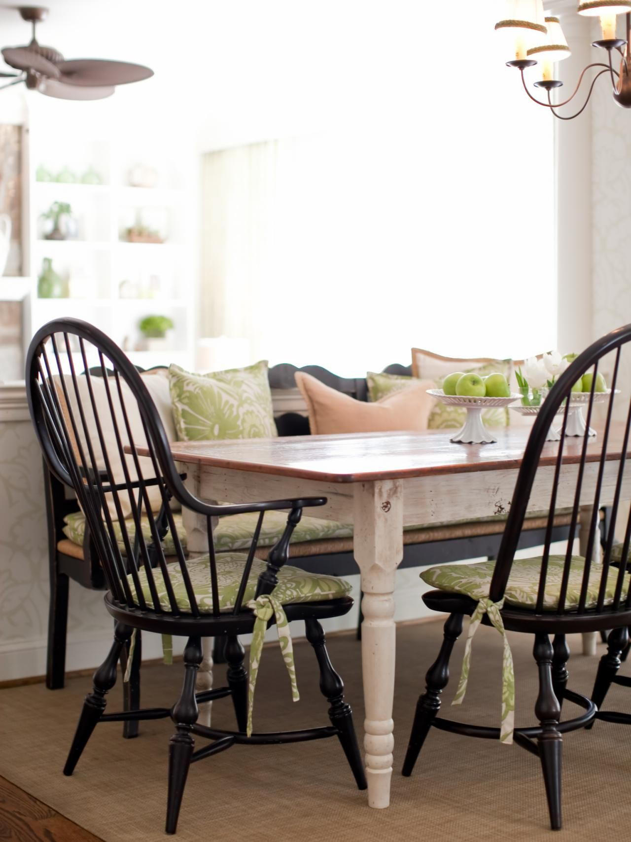 Black chair and white chair - This Country Dining Setting Features A Farmhouse Table With Black Windsor Chairs And Bench To Give