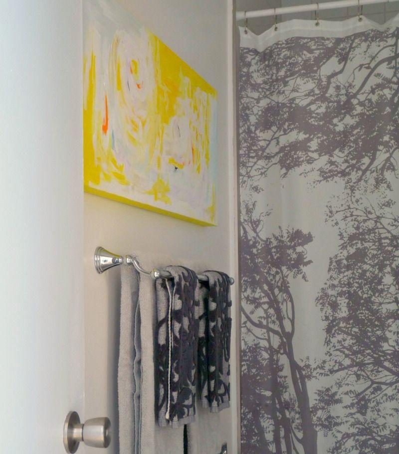 My yellow DIY abstract still shines in the grey bathroom