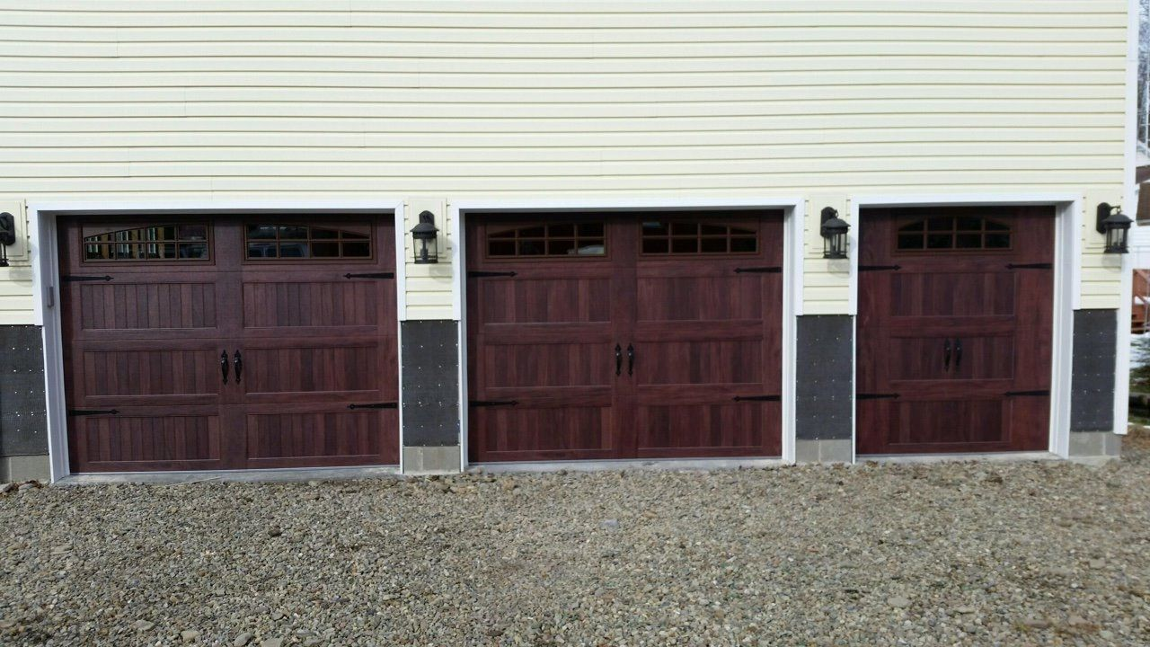 5916 C H I 2 9x7 1 6x7 Long Panel Mahogany Carriage House Door With 2 2 Piece Arched Stockton Windows Carriage House Doors Garage Doors House Painting