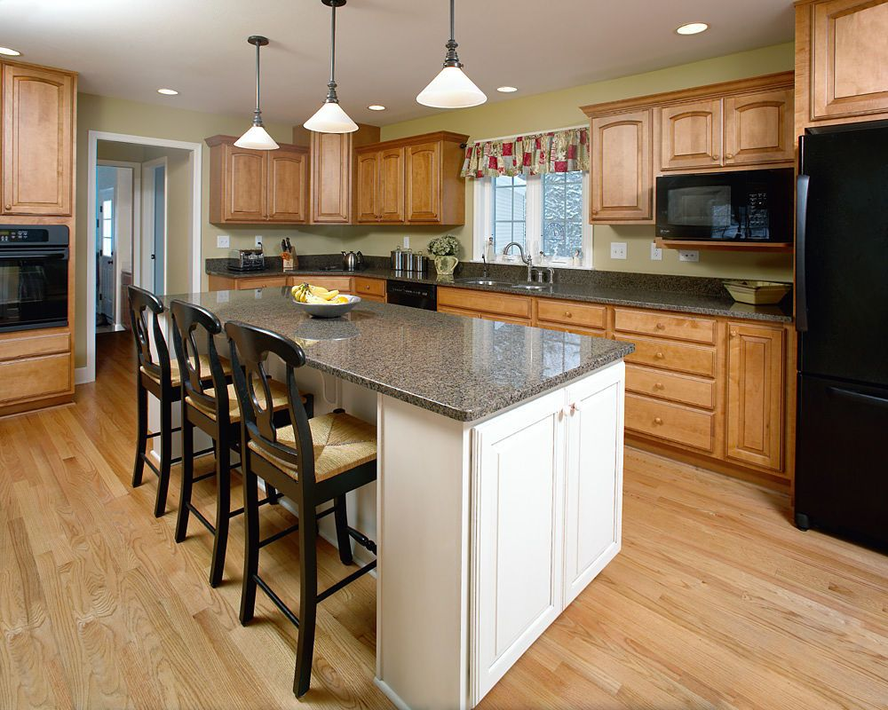 Very Neutral Natural Colors And Woodwork Make This Kitchen Feel Comfortable Casual And Kitchen Cabinet Door Styles Classic Kitchen Cabinets Classic Kitchens