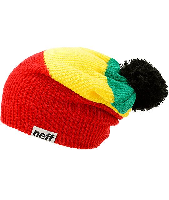 23aa6e68 Instantly brighten your style with an irie color blocked red, yellow, and  green rasta design with a solid black pom on top.