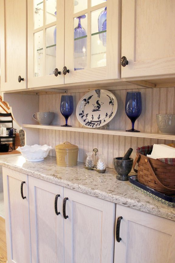 Beautiful white kitchen cabinetry accented with Cambria Windermere ...