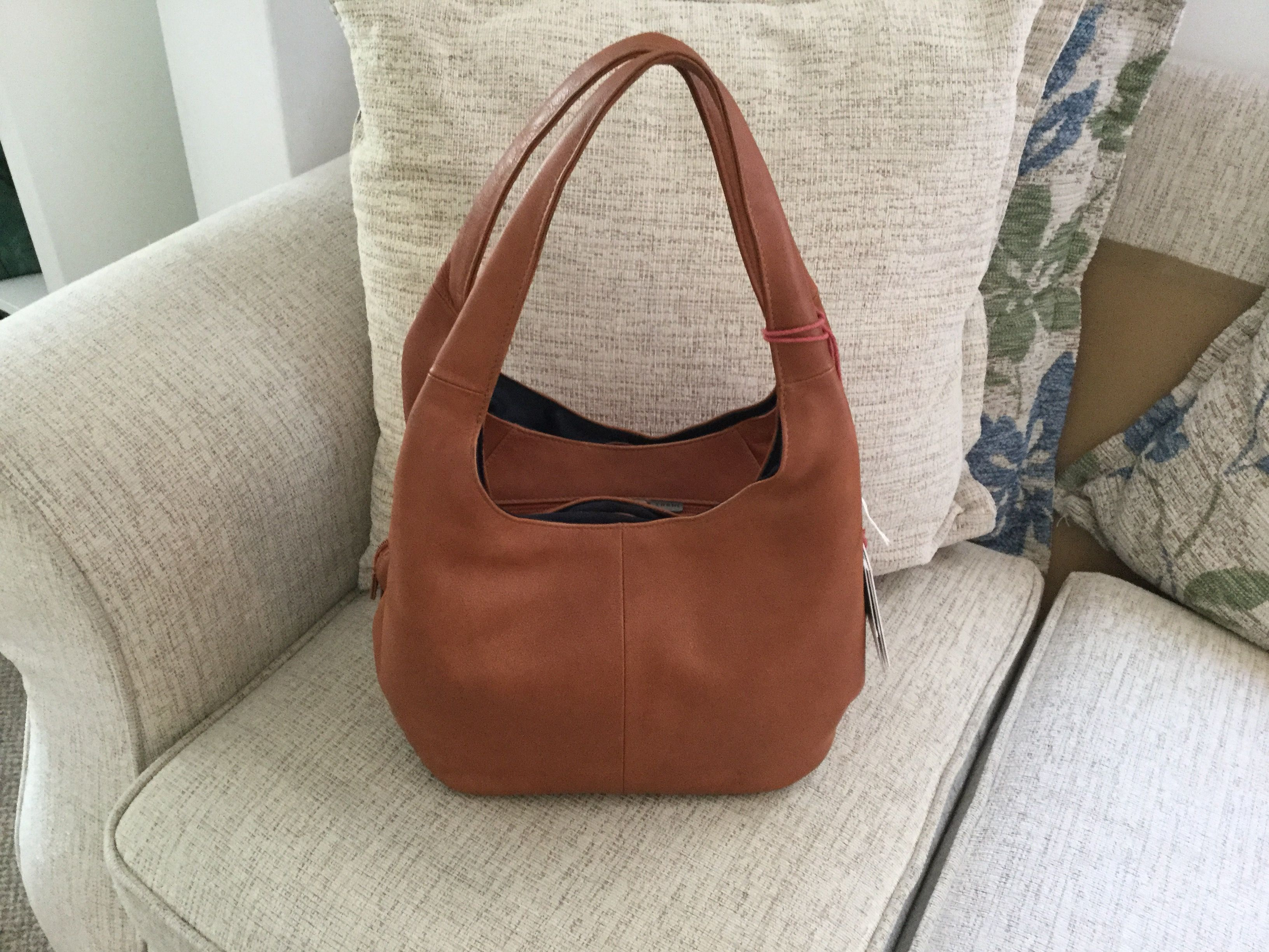 a49ef3460d Genuine leather Meehan slouch shoulder bag from the Yoshi range in Tan.