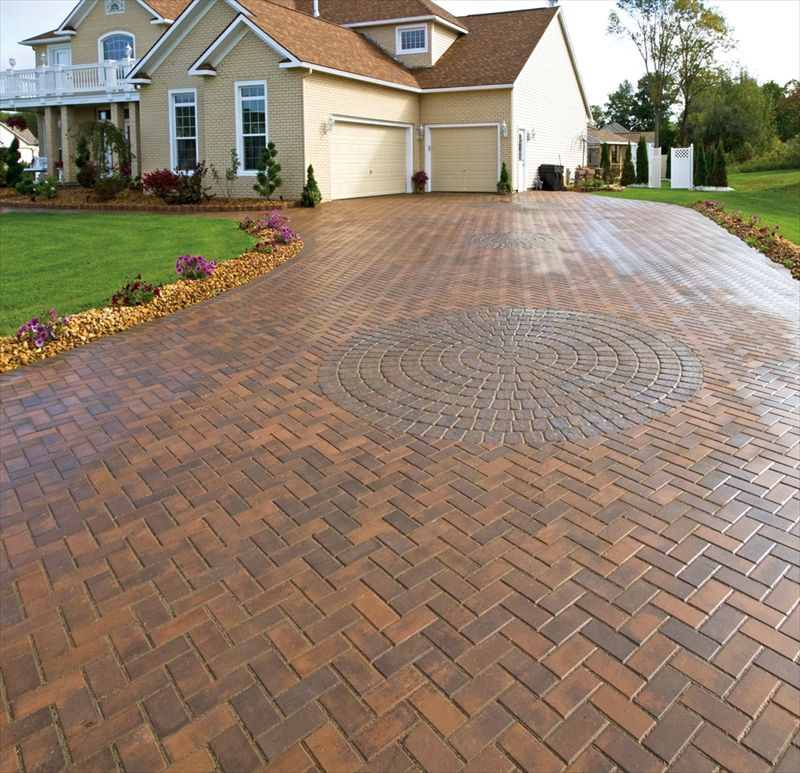 The herringbone pattern and paver art circle keep such a ...