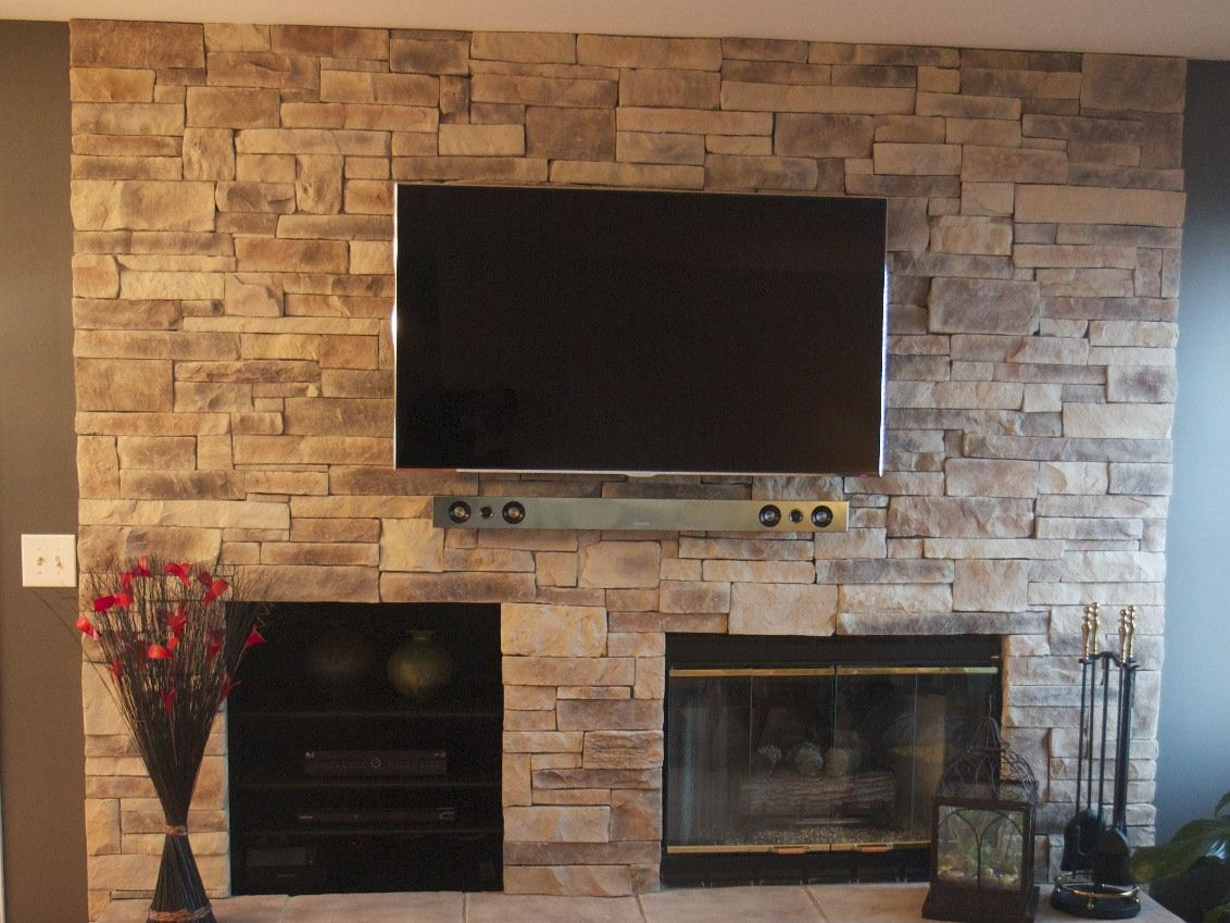 ledge stone fireplace with tv project located in round lake il