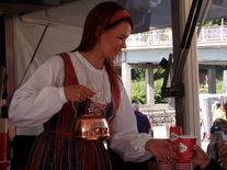 Paula-girl is chosen every year to give us some coffee.Finnish people are very fond of coffee.Paula is wearing one of the national dresses.