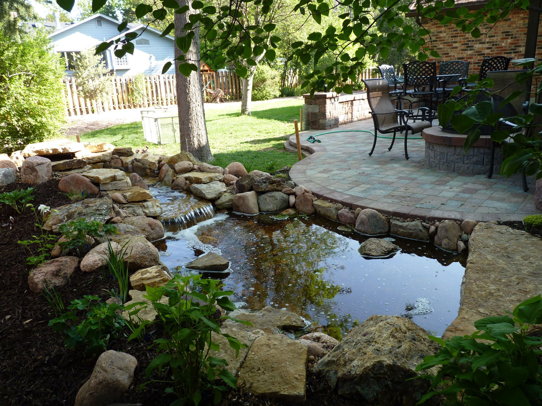 Water Feature behind firepit patio Don t want the standing water