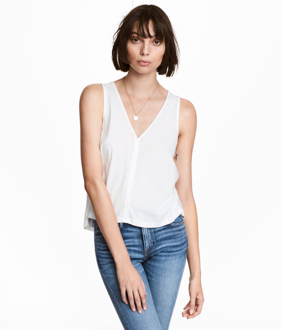 Check this out! Slightly shorter, flared tank top in soft slub jersey made from a cotton and modal blend. V-neck. - Visit hm.com to see more.