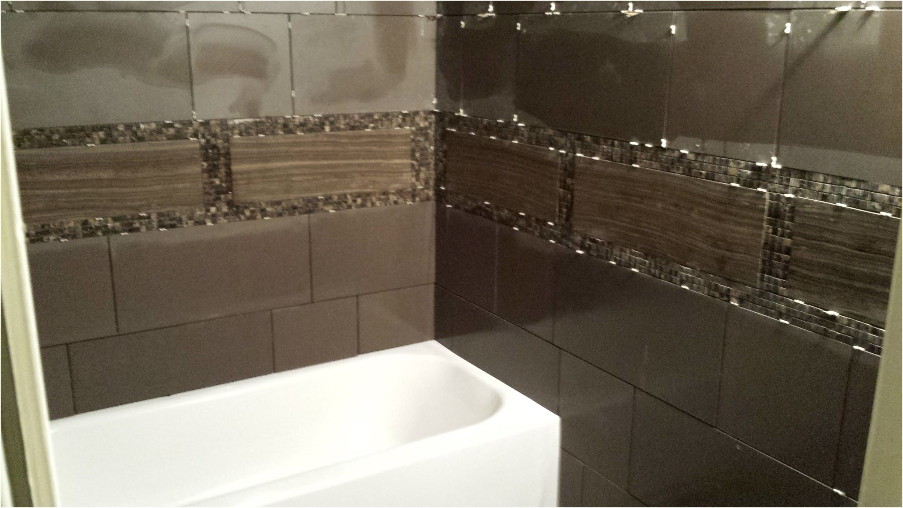 how to tile a bathroom wall youtube from How To Tile A Bathroom Wall ...