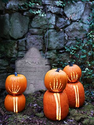Spooky Skeleton Pumpkins:  These carvings look as if they're reaching from beyond the grave.