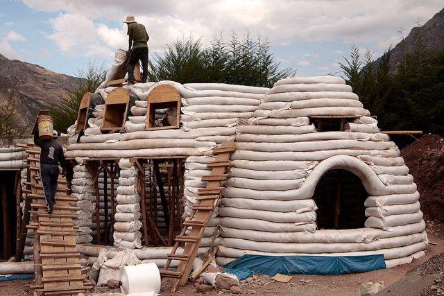 Earthbag house under construction construction for Diy adobe house