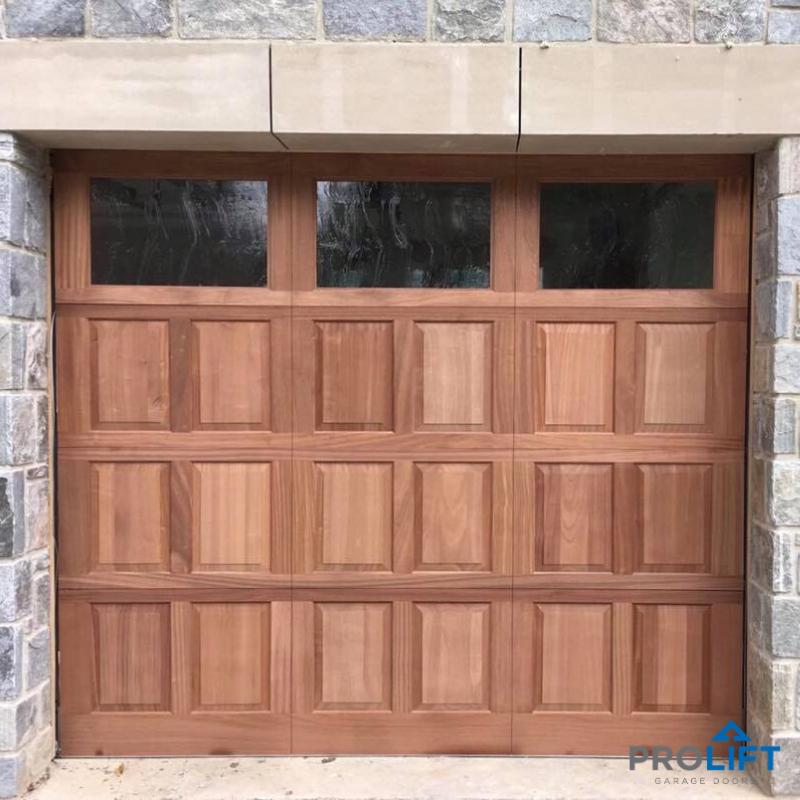 Wooden Garage Door With Glacier Glass Windows Custom Wood Garage Doors Garage Doors Faux Garage Door Windows
