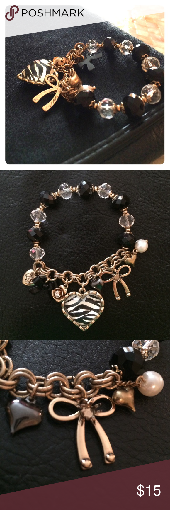 Betsy Johnson Charm Bracelet Betsy Johnson gold-tone and black charm bracelet.  Stretches to fit over your hand.  The bow charm is missing it's stone (third picture).  The charms give the bracelet a nice little jingle on your wrist! Betsey Johnson Jewelry Bracelets