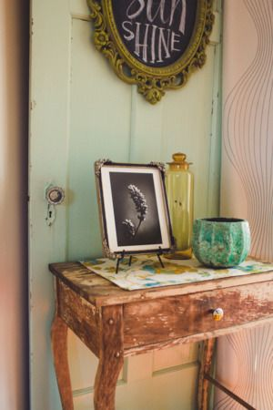 Rustic decor for the entryway.   http://domino.com