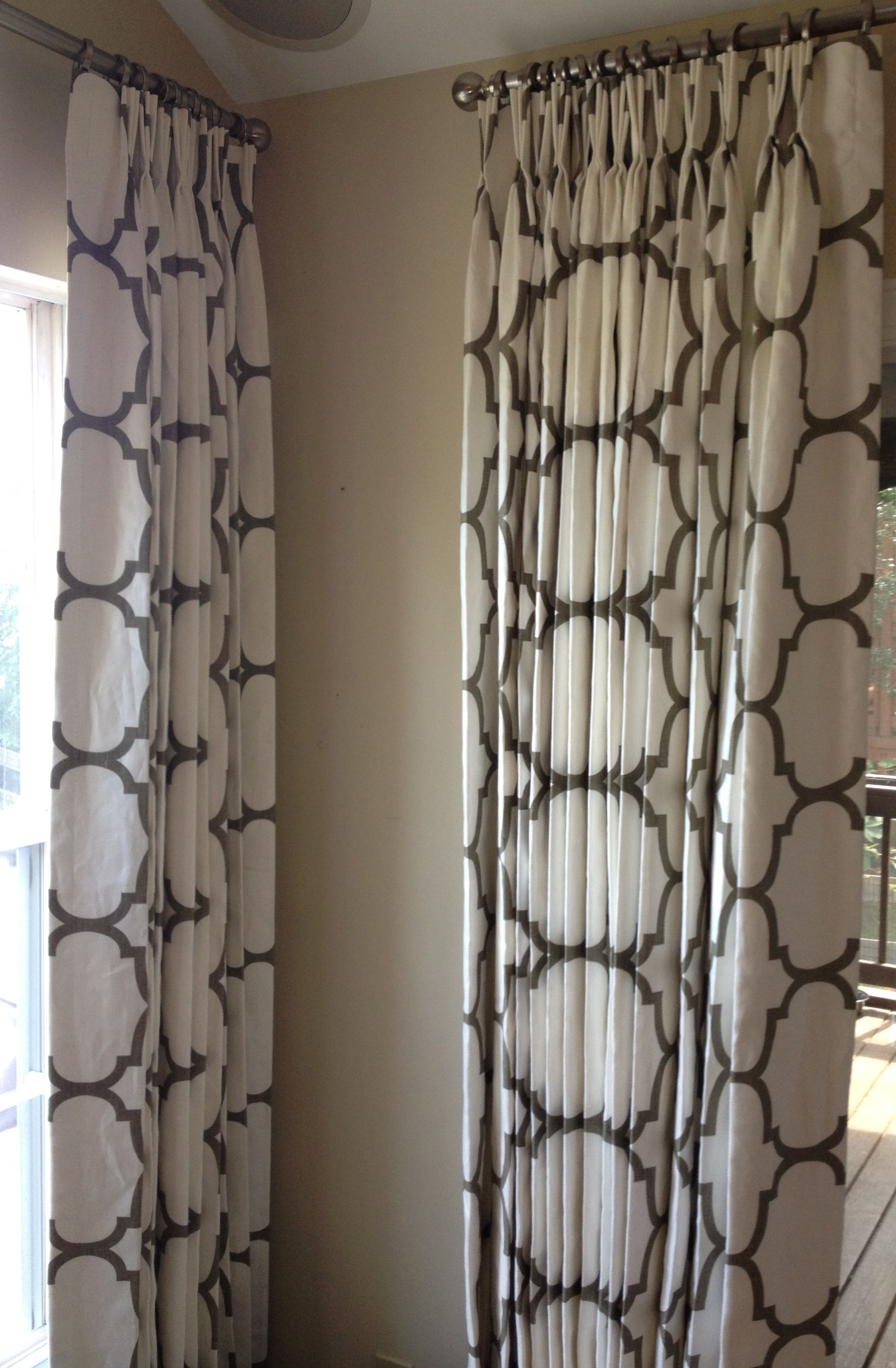 Windsor smith fabric but with wooden drapery rods living room