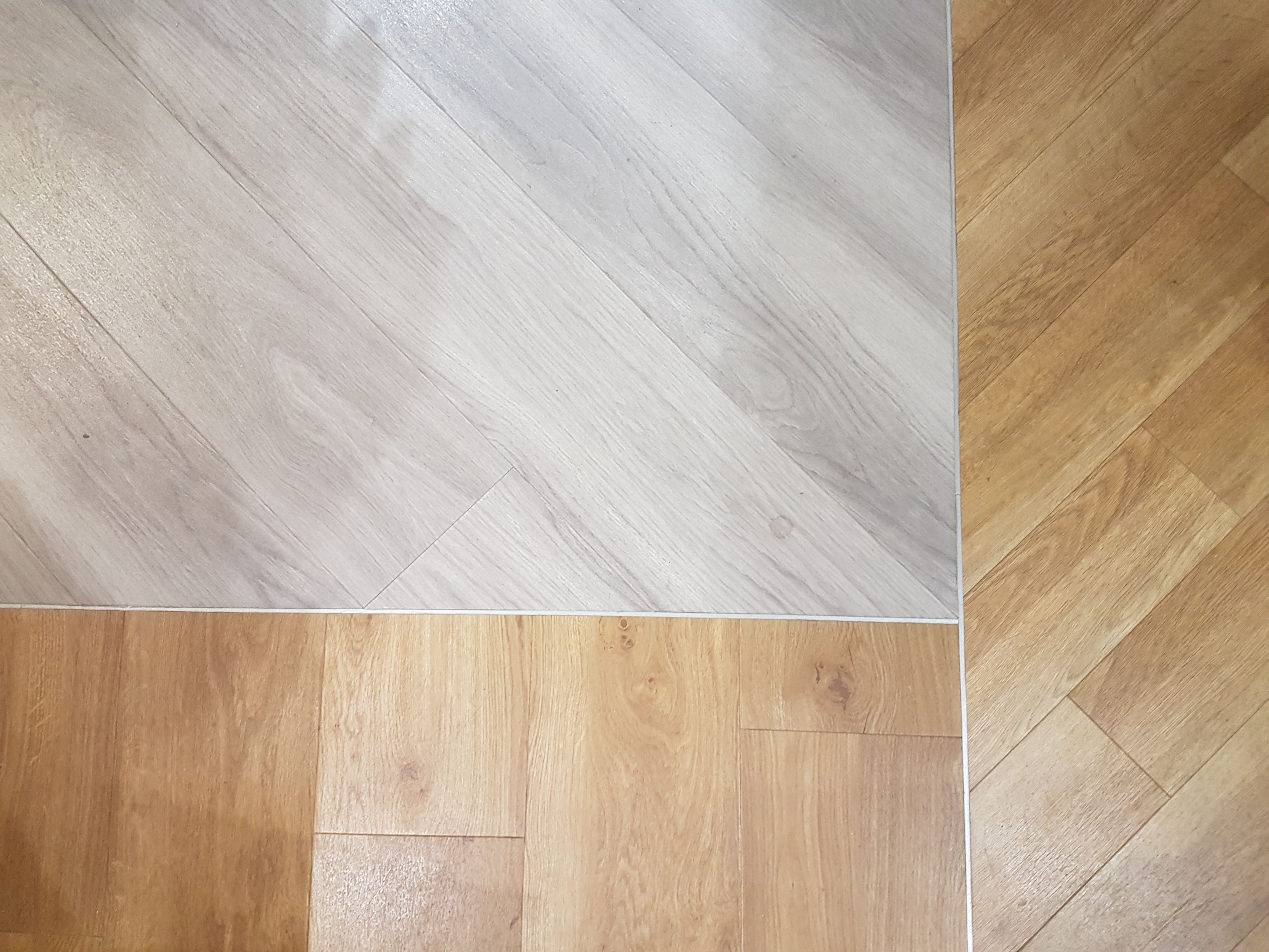 Our Showroom Floors Showcasing Top Left Corner: Amtico Spacia Nordic Oak XL  Bottom Left:: Amtico Spacia Traditional Oak XL Right: Amtico Signature  American ...