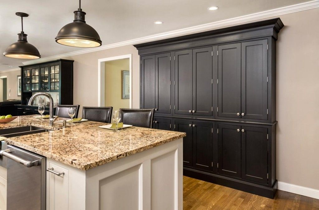 black wall of pantry cabinets in and white island built of shaker ...