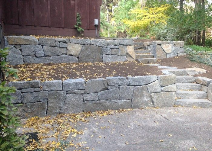 Prefer The Natural Look With Varied Gray Tones And Medium Sized Stones Granite Retaining Wal Natural Stone Retaining Wall Patio Pavers Design Bluestone Patio