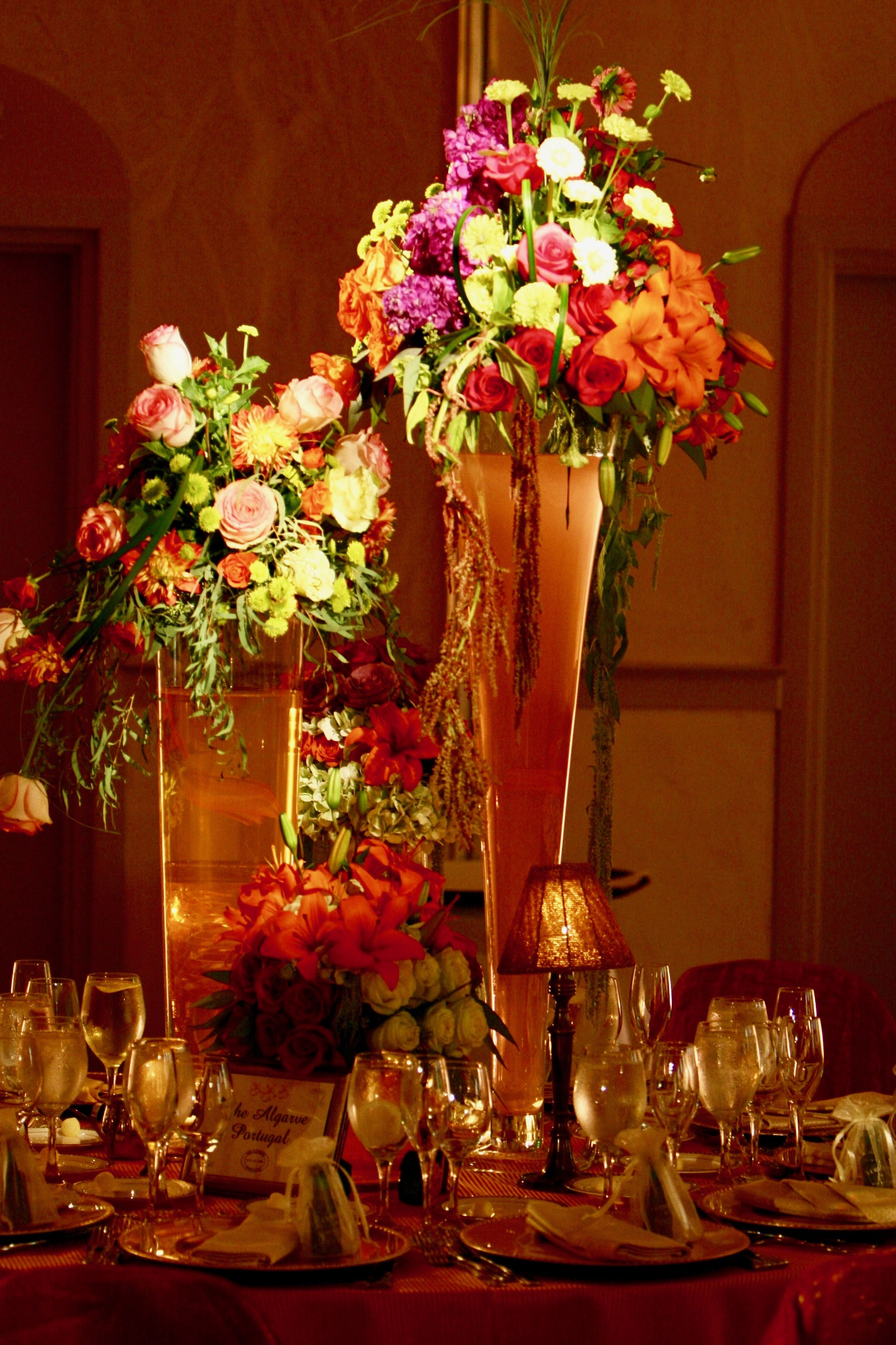 Jaw Dropping colorful flower arrangements in tall glass vases for ...
