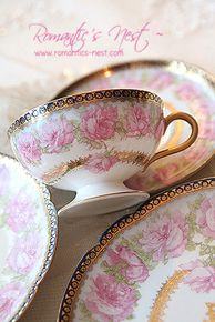 Beautiful Rose Pattern - love the pedestal base on the tea cup