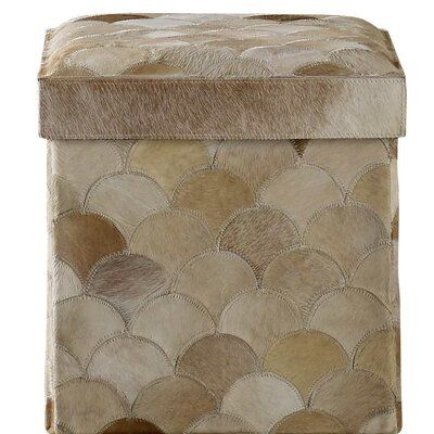 Kravet A lidded cowhides this Recherche Storage Scalloped Vanity Stool. The stool collapses flat and fits within its lid. With nylon easy to clean inner lining.