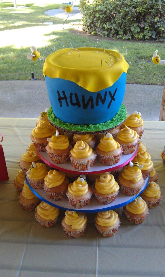 Winnie the Pooh party cupcakes and honey pot.