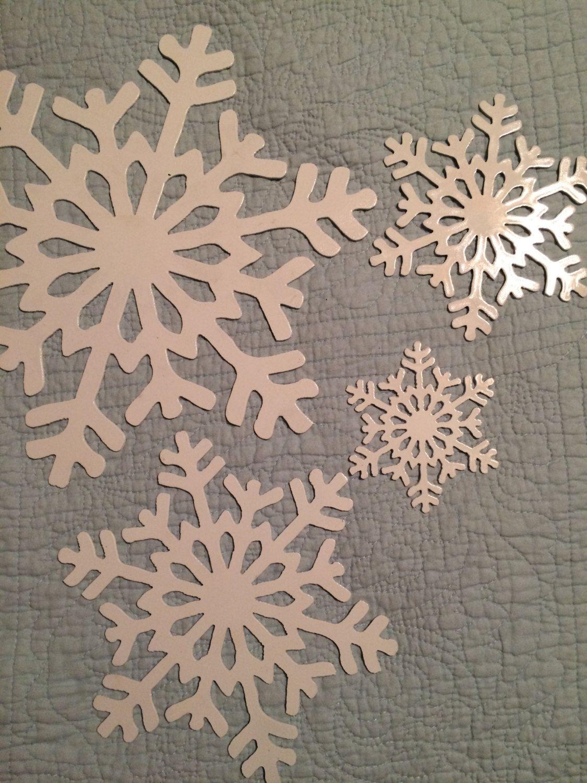 Set of four snowflakes white plasma cut wall art or tree