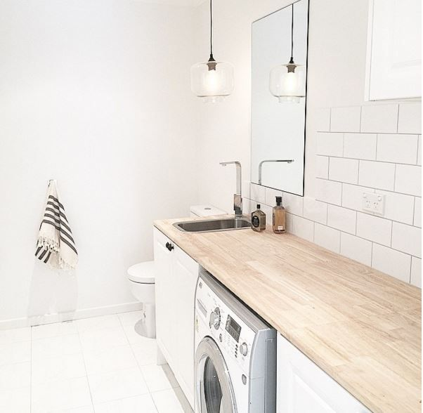 Find yourself spending a lot of time in the laundry? Three Bird Renovations recommend jazzing up the space and adding a pendant light. This reno features our Clear Laurent Pendant Light #vintagelight