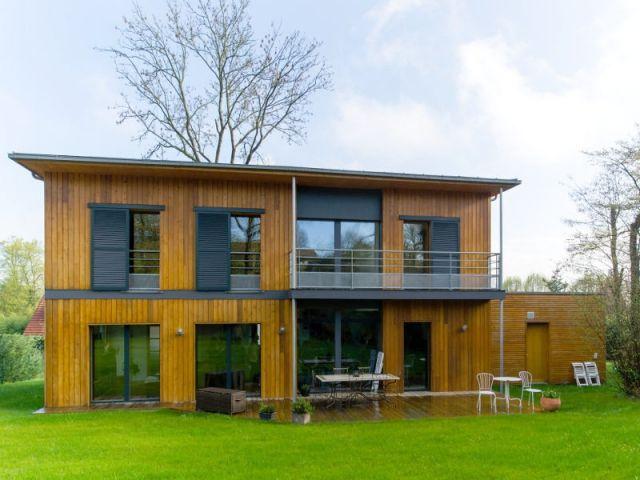 Une maison passive en bois bâtie à lu0027orée de la forêt House
