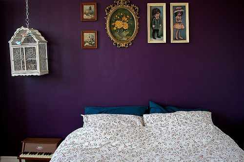 This dark purple wall will add a dark romantic feel to an otherwise