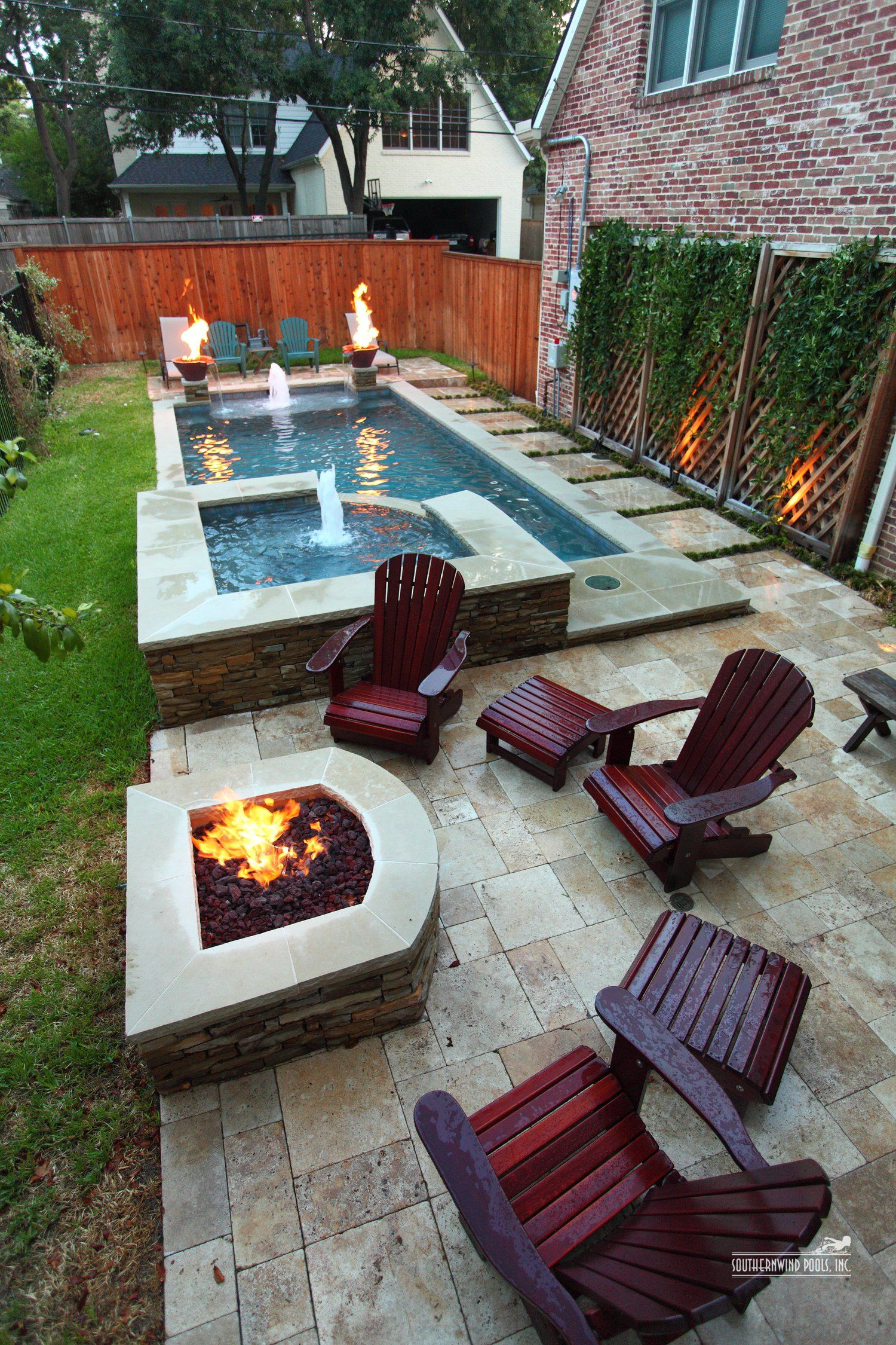 Narrow pool with hot tub firepit great for small for Small backyard pool ideas