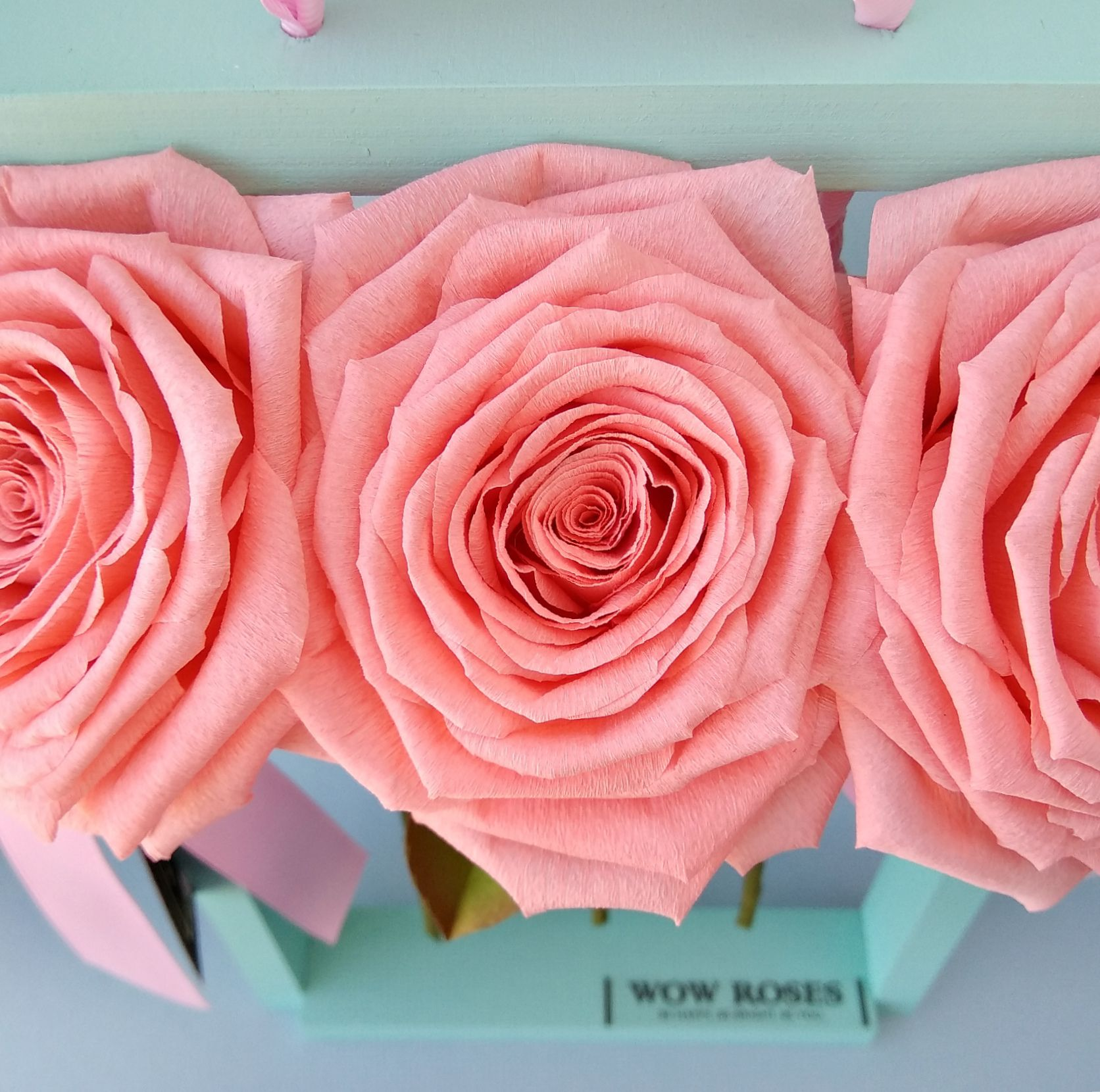 Crepe paper roses on the wooden stand #crepepaperroses