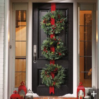Three Christmas Wreaths On Red Ribbon For Front Door