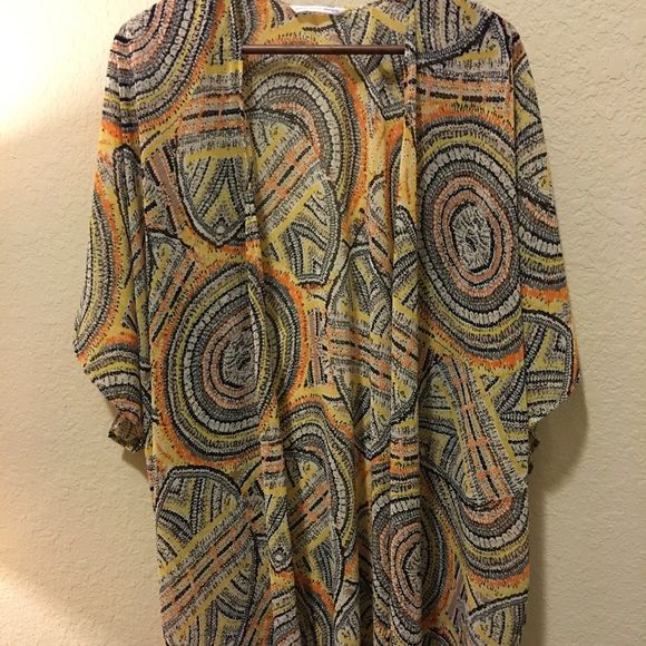 Yellow circle boho kimono Beautiful fabric. Handmade-bought from Etsy. Yellows, oranges, very comfortable. I'm 5'2 and it hits right above my knees. Perfect condition. Sweet touch designs  Jackets & Coats Capes