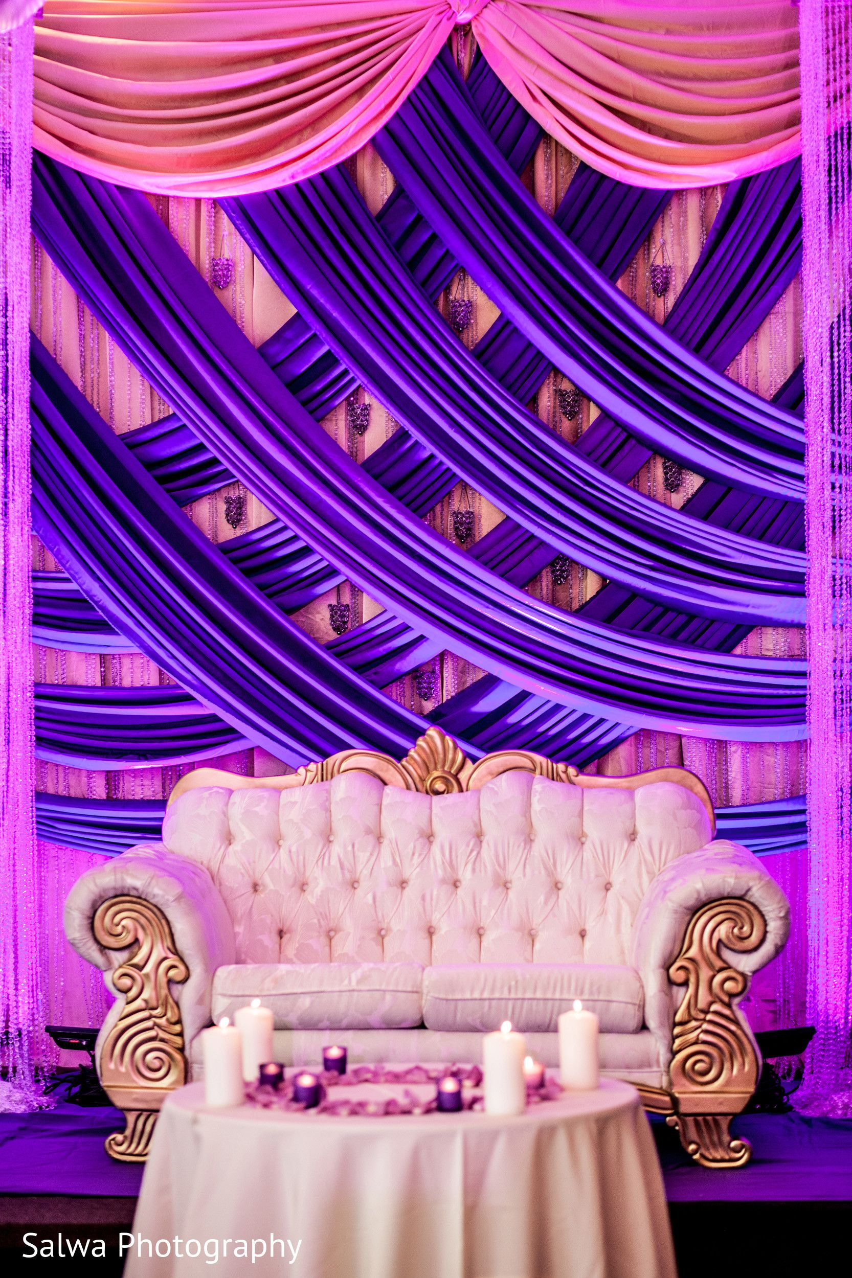 Pink and violet Curtains white sofa for a recpetion decor | Function Mania | #Trending: How to use hues of Ultraviolet for a chic wedding decor!