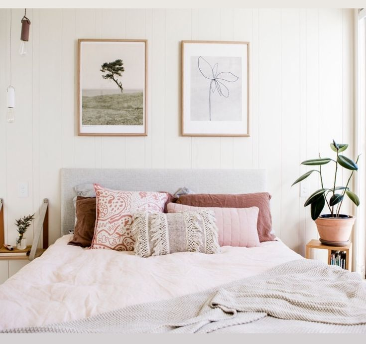 Symmetrical framed art above a bed Art In The BEDROOM in 2018