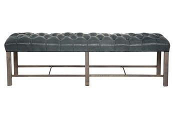 The bold statement of tufted leather in a sleek, functional bench is perfect for casual seating or a coffee table.