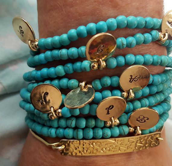Turquoise Personalized Stacking Bracelet - One Luck Bracelet - Beaded Bracelet - Initial Disc Charm - Minimalist Jewelry - Initial Jewelry - Venexia Jewelry. Each piece is unique. There might be slight variations between one piece to the other. These are the attributes of handcrafted jewelry.  Listing for ONE bracelet with ONE stamped disk  Disc material : gold filled Clasp material : gold filled Color : yellow Beads : turquoise howlite Stamped initial : ONE letter  Turquoise is one of the…