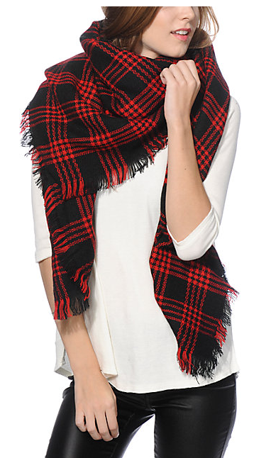 Get the comfort of your favorite blanket with the trendy style of a scarf in this black and red plaid blanket scarf, made with a soft red and black woven construction finished with fringe detailing along them hems.