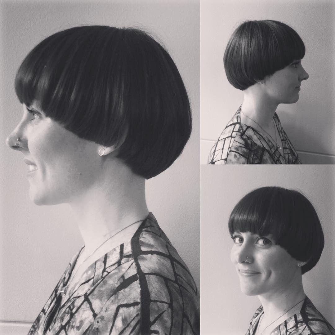 a short brown straight bowl-cut multi-tonal womens haircut hairstyle