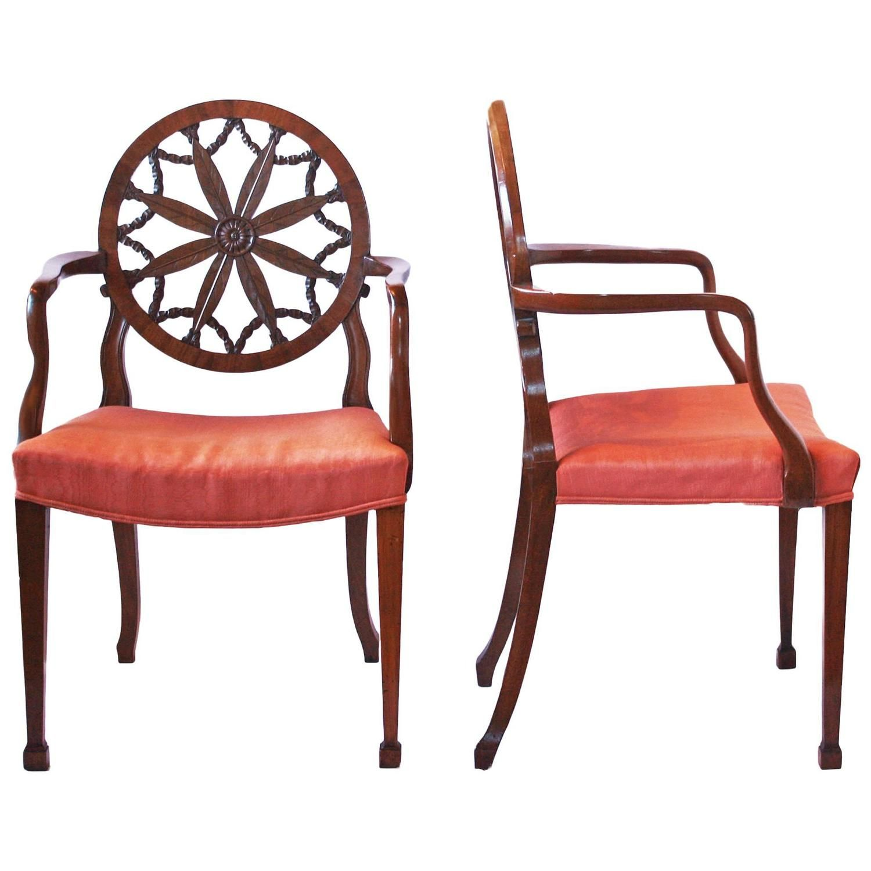 A pair of George III mahogany Hepplewhite period wheel back open