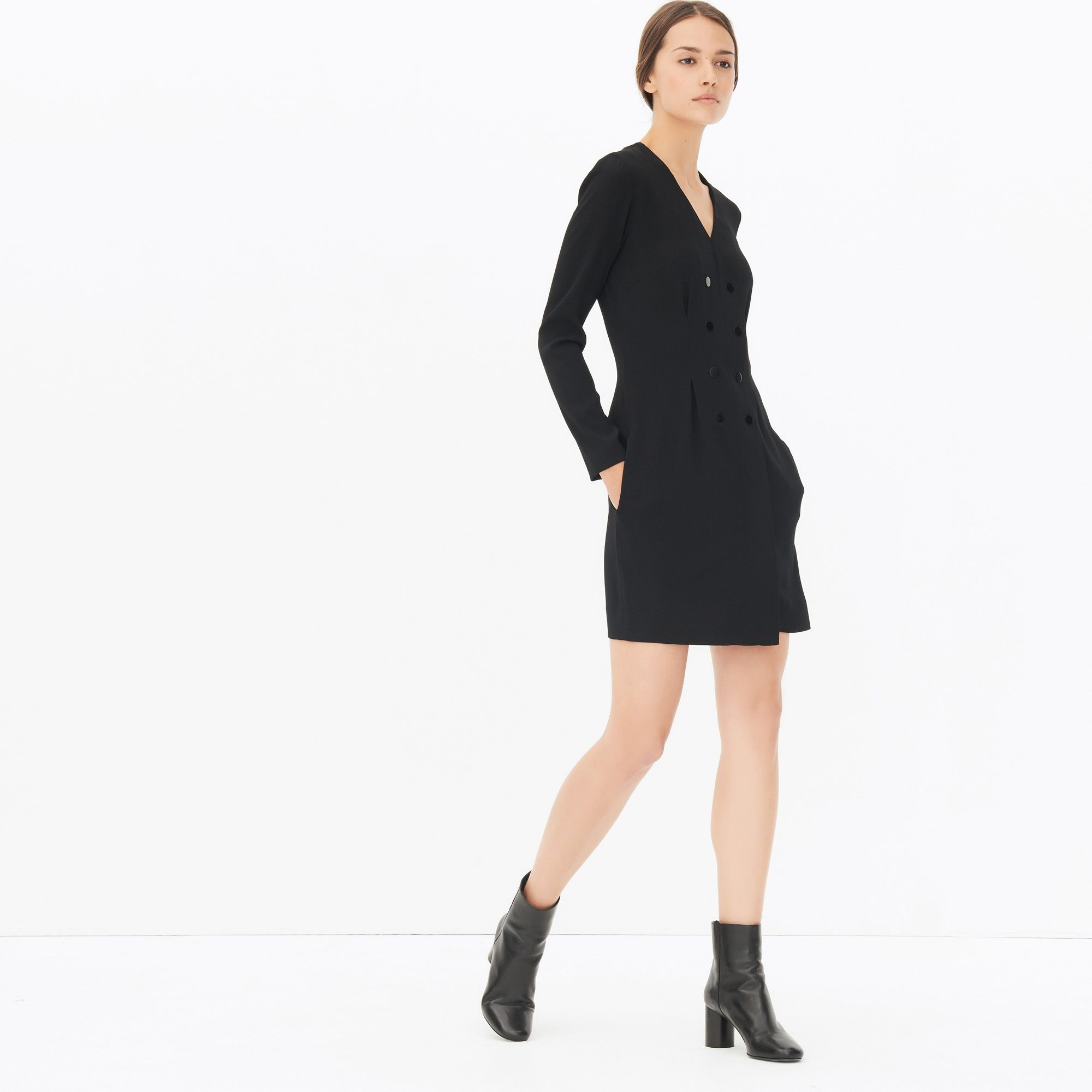 Sandro long dress with long sleeves and V-neck. Double-breasted press-stud fastening. Two pockets with piping. Invisible zip fastening on the side. Simple and chic, this dress is perfect for any occasion. Model is wearing a size 1.