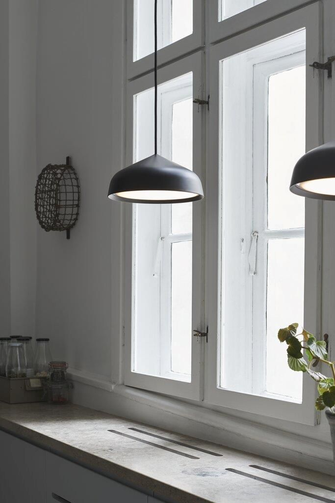 Fura's stylish design gives it a minimalist and modern expression. The opal bottom shade diffuses a soft and pleasant light, and the silky matte metal shade gives a contemporary edge. Designed by Bønnelycke mdd. 💡  #lights #lighting #lightingdesign #lamp #pendantlight #kitchendesign #kitchenisland