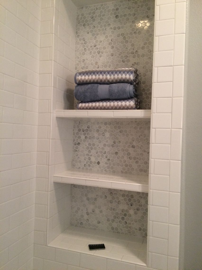 Bathroom Nook white subway tile and carrera marble hexagon tile accent shower