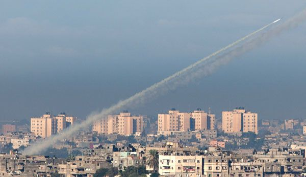 A rocket is launched from Gaza towards Israel today as the Israeli military continues a series of air raids and naval attacks on Palestinian militant targets for a second day. Photograph: Uriel Sinai/Getty Images