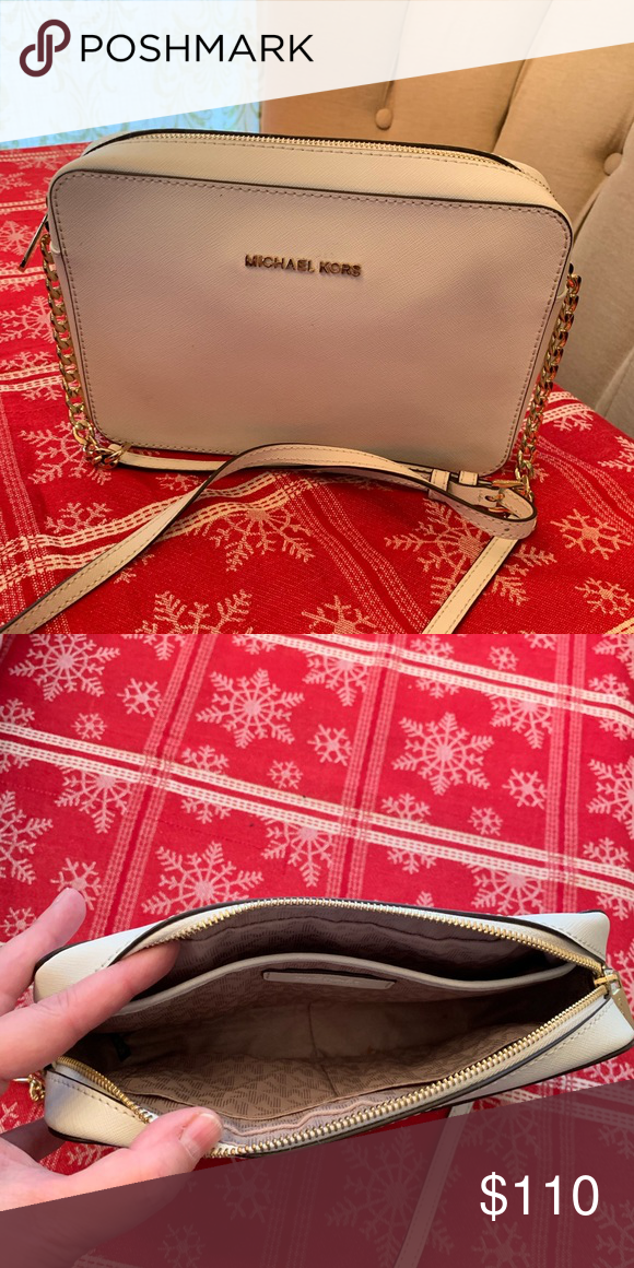6d98de9cb655 Authentic Michael Kors white purse White handbag with white and gold chain  strap. Very spacious
