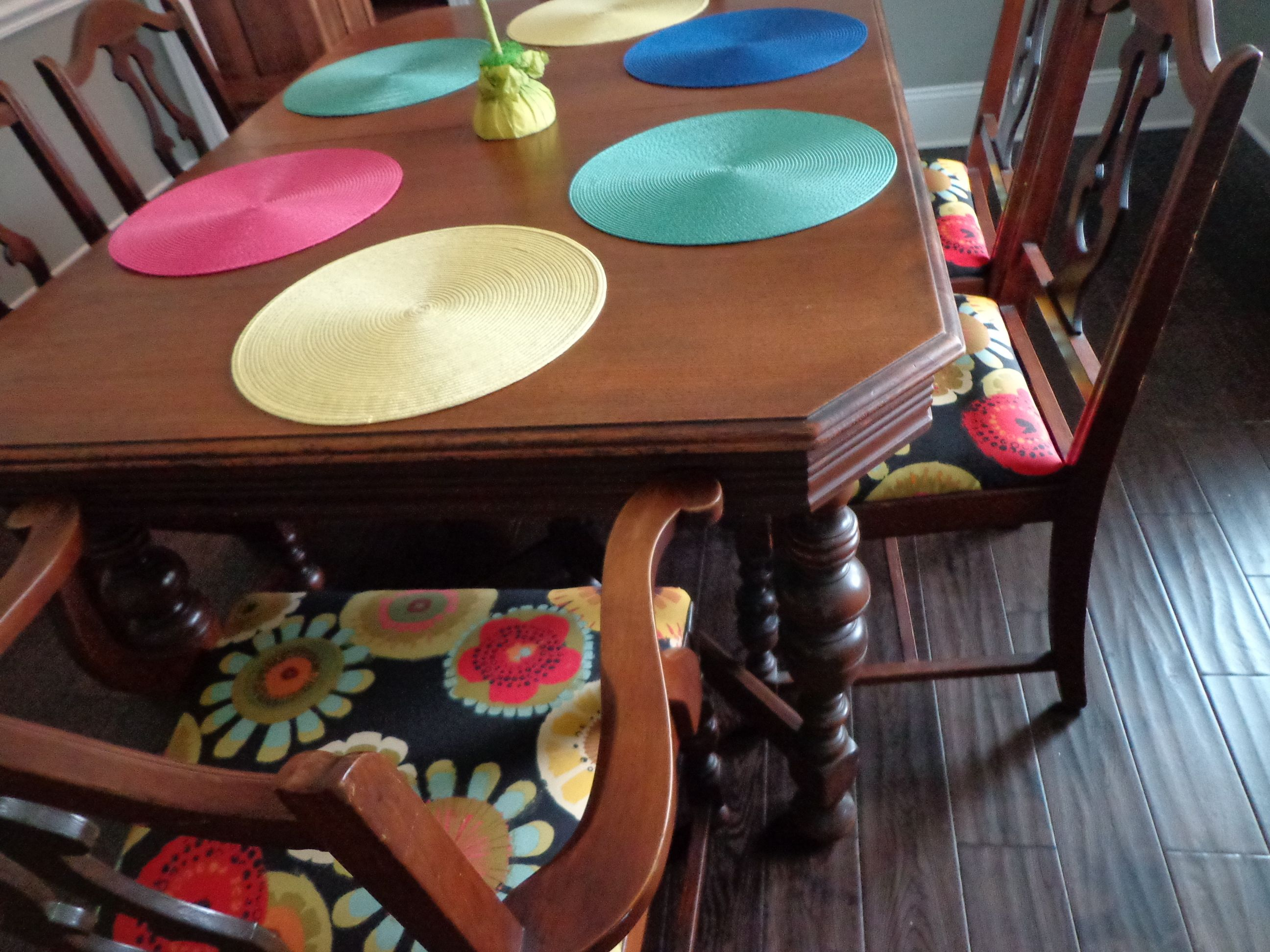 Floral on chair seats and bright colors on place mats curtains