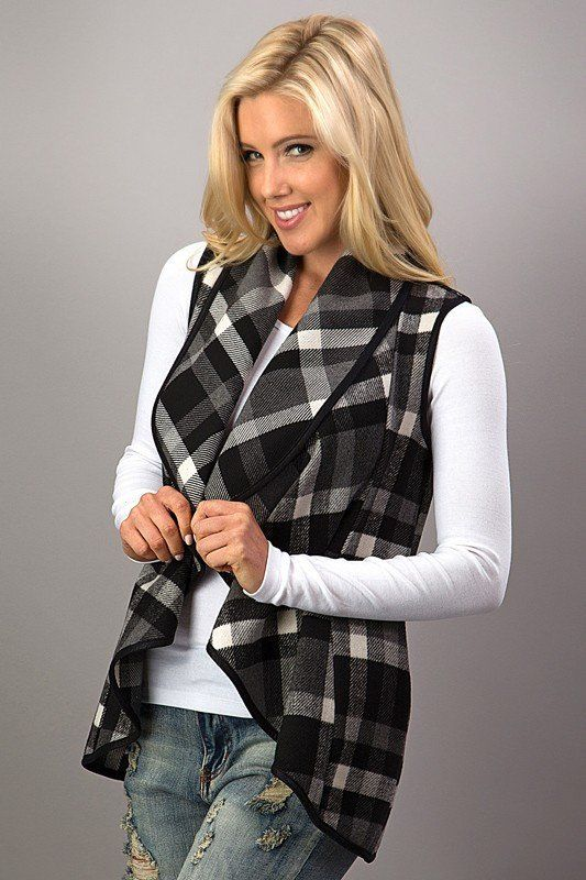 These plaid vests are so perfect to throw on and go! They are an absolute must have for Fall and Winter! This vest features a waterfall style, open front, & faux leather piping with side pockets. Fabr
