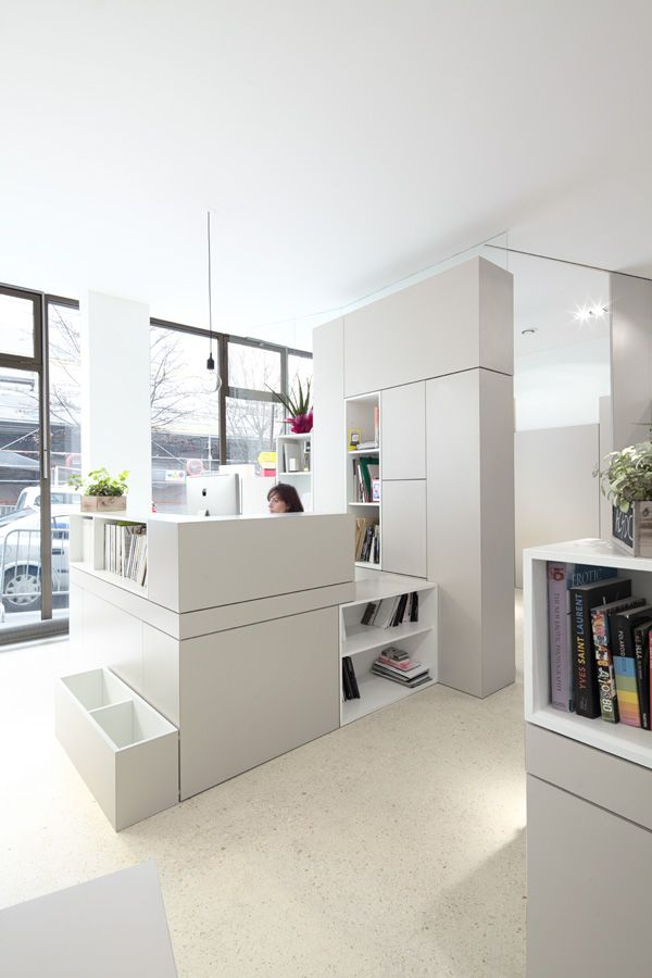 Unique Front Desk In Luxurious White Office Interior